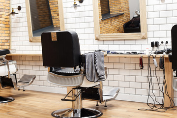Empty barbershop with armchairs