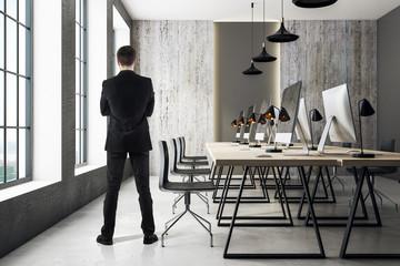 Businessman in modern coworking office
