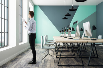 Man in contemporary coworking office