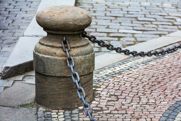 fencing in form of posts with iron chains