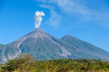 Amazing volcano El Fuego during a eruption on the left and the Acatenango volcano on the right, view from Antigua, Guatemala