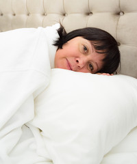 woman lies in bed