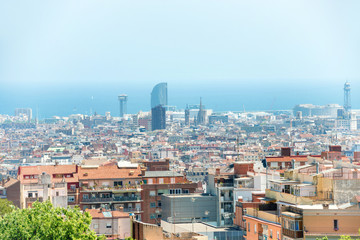 Panoramic view of city of Barcelona, cityscape with buildings and blue sea