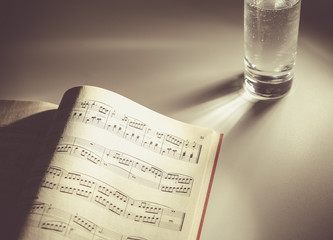Sheet music with glass of water
