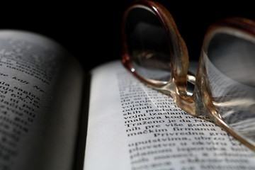 Old Reading Glasses On Old Book