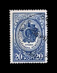 Alexander Nevsky medal (order), circa 1944. canceled vintage postal stamp printed in USSR (Soviet Union) isolated on black background.
