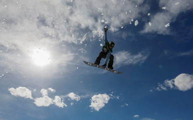 An athlete soars during Gorilla Winter Jungle snowboarding and freestyle skiing festival at Shymbulak ski resort outside Almaty