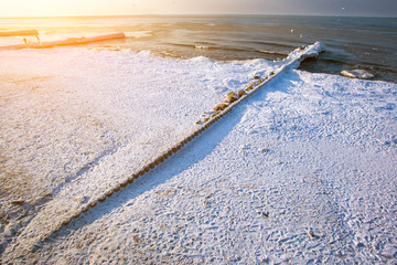 snow-capped beach and frozen sea, toned