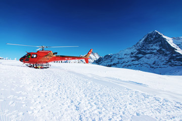 Printed roller blinds Helicopter Red helicopter Swiss Alpine mountain Mannlichen in winter