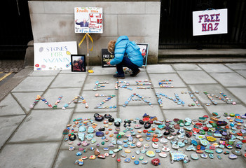 Stones and placards with messages are placed on the pavement outside the Foreign and Commonwealth Office  during a demonstration to demand the release of Nazanin Zaghari-Ratcliffe, who is imprisoned in Iran,  in London,
