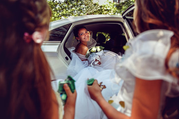Portrait of a Beautiful bride sitting in the car.
