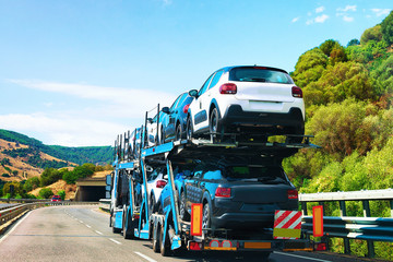 Car transporter on road in Nuoro Sardinia