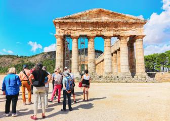 Tourists at Doric temple in Segesta in Sicily