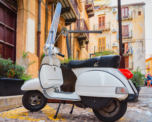 Scooter in street of Cefalu old town Sicily