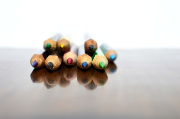 wooden pens in color and reflection