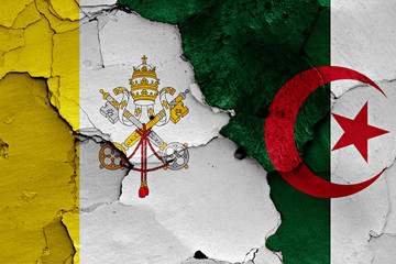 flag of Vatican and Algeria painted on cracked wall