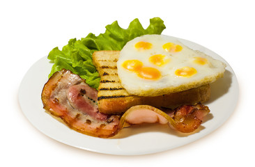 Grilled toast with bacon and fried quail eggs on the lettuce. White isolated background.
