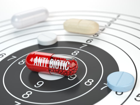Pills on target and antibiotic in the center.  Scientific research or best prescription medication concept.