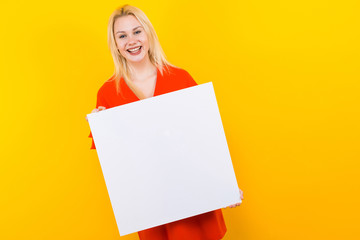 Blonde woman in dress with blank paper