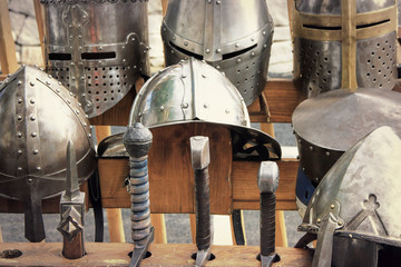 Medieval armors: helmets and swords