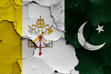 flag of Vatican and Pakistan painted on cracked wall