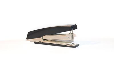 Black stapler on a white background