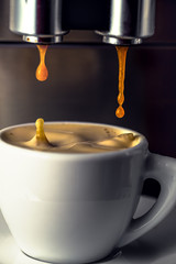 Pouring fresh espresso coffee in a cup