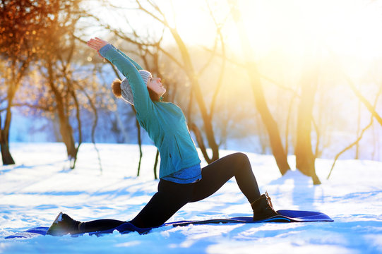 Woman practicing Crescent Lunge yoga Pose in the morning