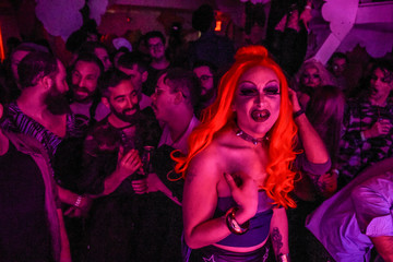 A drag queen named Mini Horrorwitz who serves as judge reacts to the crowd during a drag queen competition called MR(S) BK in the Brooklyn borough in New York City