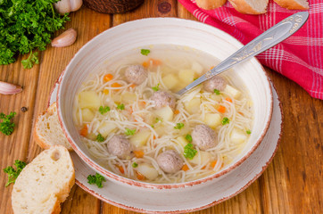 Chicken soup with meatballs and noodles