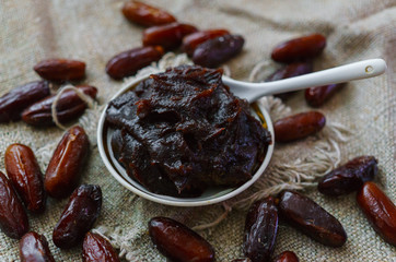 Raw Organic Fresh dates together with fint jam from dates .