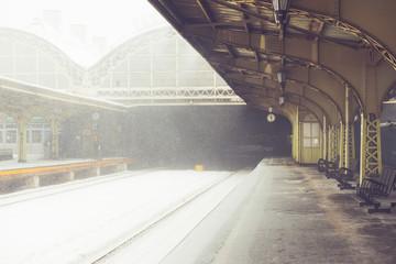 Empty snowy platform on railway station