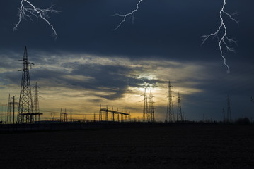 lightning falling on the high voltage pylons