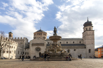 Trento, Italy- 9 March, 2018: Neptune fountain in Cathedral Square, Trento, Italy. main square Piazza Duomo with the Late Baroque Fountain of Neptune. Trento is the city in Trentino , northern Italy.