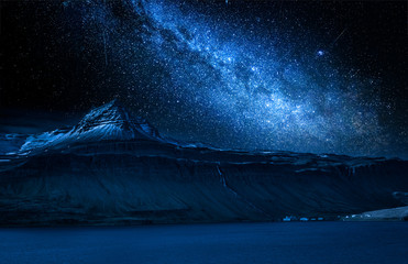 Fototapete - Milky way and volcanic mountain over fjord at night, Iceland