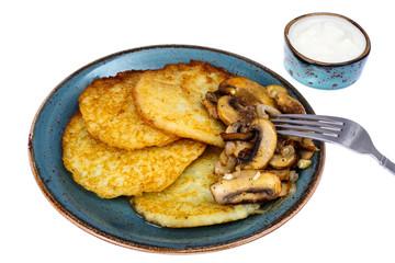 Hot potato pancakes with fried mushrooms