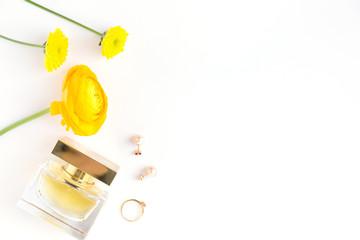 Romantic arrangement of perfume and flowers
