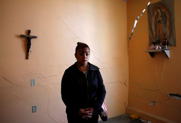 A woman affected by the September 19, 2017 earthquake is pictured inside her home before she takes part in a march, where they say they are demanding transparency in the delivery of resources for the reconstruction of infrastructure