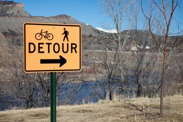 Orange detour sign on the Animas river trail in Durango, Colorado
