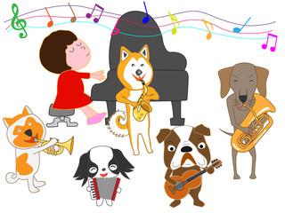 犬のコンサート。子供と犬が歌ったり、楽器を演奏したりしている。