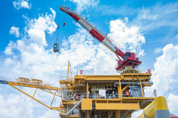 Offshore oil and gas wellhead remote platform produced crude oil and natural gas for sent to onshore refinery and floating storage tanker, Power and energy business.