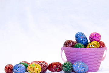 Easter egg basket with  many eggs around
