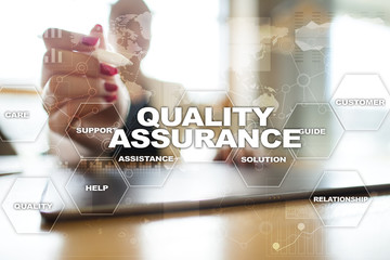 Quality assurance concept on the virtual screen. Business concept.