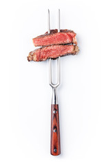 Photo sur Plexiglas Viande Slices of beef steak on meat fork on white background