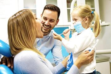 Family in dental office
