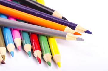 colorful color pencil stacked on white background ideal for back-to-school and education concept