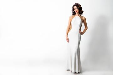 beautiful chic woman in white long dress