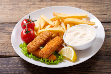 plate of fish sticks with french fries
