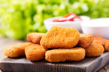 chicken nuggets on wooden board Wall mural