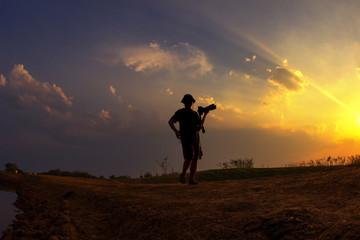 Silhouette sunset photographer shooting photo